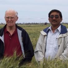 Arun Joshi (right) with Norman Borlaug in 2006