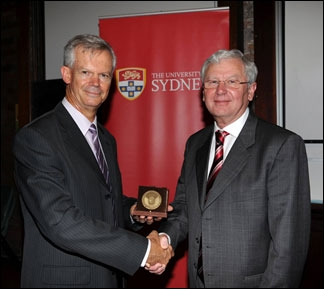 Colin Wellings, left, receiving the 2011 Farrer Award